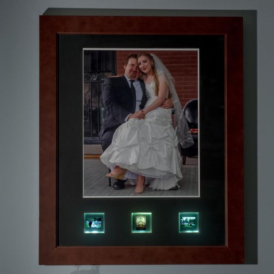A lovely custom matboard and beautiful frame displaying a photo from a wedding