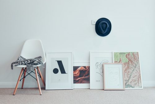 matboards and frame on the floor by the wall